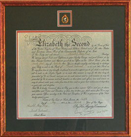 elizabeth certificate, framed military awards, cap badege, regimental awards